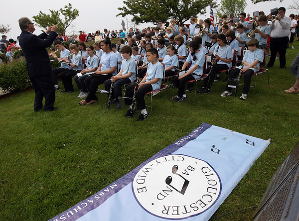 "Members of the Gloucester City Wide School Band play ""God of Our Fathers"" at McKinnon Triangle for Gloucester's Memorial Day ceremony yesterday morning. Photo by Kate Glass/Gloucester Daily Times"