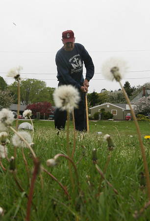 Kenny Aptt of Gloucester practices his golf swing on Thursday before heading to Cape Cod with his friends for a weekend of golf. Aptt was hoping the weather would hold out for the trip. Photo by Kate Glass/Gloucester Daily Times