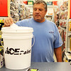 DAVID LE/Gloucester Times. Peter Couture, of Gloucester, drops a ballot with his name into a raffle bucket for a pair of tickets to a North Shore Music Theater show at the grand opening of the Hometown Ace Hardware store on Friday afternoon. 5/13/11.