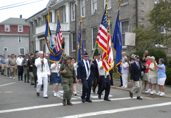 Spectators applaud as Rockport's veterans march past the Rockport Library during the Memorial Day parade yesterday. Photo by Gail McCarthy/Gloucester Daily Times