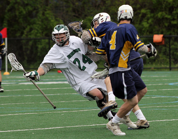 Manchester: Manchester Essex's Cooper Riehl hangs onto the ball as he gets knocked down during their game against Lynnfield at Coach Ed Field Field yesterday. Photo by Kate Glass/Gloucester Daily Times