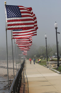 Gloucester: The flags on Stacy Boulevard were put up yesterday morning for the Memorial Day holiday and will remain up through the summer. Photo by Kate Glass/Gloucester Daily Times