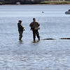 DAVID LE/Gloucester Times. Two bass fisherman take a break from fishing in the Annisquam River and chat on Friday afternoon. 5/13/11.
