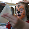 Calvin DelVecchio check out his face paint after being transformed into a tiger by Anna Landgren at the Empty Bowl Dinner at Cruiseport yesterday. Photo by Kate Glass/Gloucester Daily Times