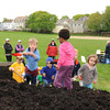 Gloucester (Little Helpers) from left, Luke McElhenny 5, Cal White 5, Harley White 2, Kyizha Verges 5, Zac Haine 4, Ruby McElhenny 3, shovel up some compost to be brought to the planting area at Burnhans Field Saturday afternoon.The group formed a community garden for people who like gardening but don't have the space.Desi Smith/Gloucester Daily Times.