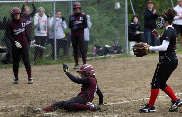 Rockport's Hannah Lorden slides safely into home plate on a wild pitch thrown by North Andover's Kim Crucioli yesterday afternoon. Photo by Kate Glass/Gloucester Daily Times