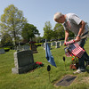 Manchester: Bob Cannon of Magnolia helps replace American flags on veterans' graves for Memorial Day at Rosedale Cemetery in Manchester. Members of the American Legion volunteer to set out flags before Memorial Day and bring them in after Veterans Day. Photo by Kate Glass/Gloucester Daily Times