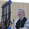 Gloucester: Rabbi Samuel Barth of Temple Ahavat Achim, gives thanks as he looks at the Manoura survived the 2007 fire, that was brought back sunday morning.Desi Smith/Gloucester Daily Times.