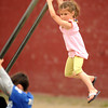 (Hanging with the Boys) Serena Sawyer 6, looks at the other boys as she hangs on a pole a little higher than them at Boudreau Field Saturday afternoon. Serena is very competive said a friend, as she has two brothers who play sports and always competes with them. Desi Smith/Gloucester Daily Times.