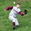 Rockport captain Derick MacDowell slides down the hill in right field to catch a fly ball during their game against Amesbury at Evan's Field yesterday. Photo by Kate Glass/Gloucester Daily Times