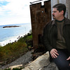 "Gloucester composer Robert Bradshaw looks out over Gloucester Harbor and Norman's Woe, which inspired his latest piece, ""Norman's Woe,"" which will have its world premiere during the Cape Ann Symphony's Spring Pops Concert this Saturday at 8 p.m. Photo by Kate Glass/Gloucester Daily Times"