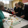 Sandy Jones chats with Gloucester Mayor Carolyn Kirk as they hand out cake during the Rose Baker Senior Center's 10th Anniversary Celebration yesterday afternoon. Photo by Kate Glass/Gloucester Daily Times
