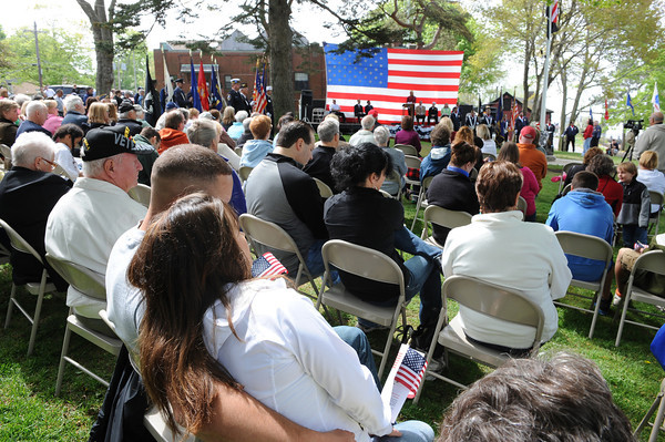 Magnolia:  Kyle Benson who served with the 1st Battalion 11th Marines sits his girlfriend Michelle Greenlaw, as they listen to Lisa Ramos closing remarks at the unveiling ceremony in Knowlton Park in Magnolia,honoring all service branches. Saturday morning at the unveiling and ceremony in Knowlton Park in Magnolia.  Desi Smith/Gloucester Daily Times.