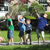 Manchester: Marco Bussone, Frank Wood, Will Russo, Atticus Smith, Oliver Reineman, Davide Bussone, and Nate Ray launch paper airplanes outside the Manchester Public Library yesterday afternoon as part of the Sally Ride Day Paper Airplane Contest. The kids measured how far their airplanes traveled as well as how high they flew. Photo by Kate Glass/Gloucester Daily Times