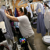 Soraia Silva places a dress shirt on a machine to be pressed at Nor'east Cleaners. The company is the only dry cleaning business on the North Shore that uses an environmentally friendly process for their dry cleaning. Photo by Kate Glass/Gloucester Daily Times
