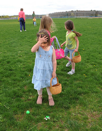 Essex: Essex: Lily Lower 4, of Gloucester is suprised at the sight of an open easter egg with the candy outside. She then picked up the candy quickly moved on to find other eggs, saturday afternoon at Memorial Field.  The Easter egg hunt was sponsored by Manchester-Essex Rotary Club.  Desi Smith/Gloucester Daily Times.