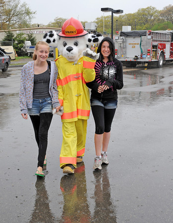 Rockport:  K.T Favoloro 11, and Jane Quirk 12, walk in the rain with Sparky at the Rockport Ambulance Corps 16th Annual Emergency Services Day at the DPW Yard Sunday afternoon. Desi Smith/Gloucester Daily Times.