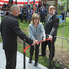 Magnolia: Mike Ramos and Rick Peek help Betty Cannon cuts the ribbon at the unveiling ceremony in Knowlton Park in Magnolia. honoring all service branches, Saturday morning. Fran Hines was to do the honor, but fell ill. Desi Smith/Gloucester Daily Times.