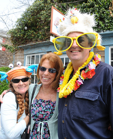 Rockport: Left to right Synda Green,Suzanne and Illustrator/Artist Tom Garrity of Rockport, pose for a photo along Bearskin Neck at Motif#1 Celebration Day Saturday afternoon. Desi Smith/Gloucester Daily Times.