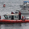 The U.S. Coast Guard picked up three boaters after their vessel begain taking on water near the Blynman Bridge yesterday afternoon. Photo by Kate Glass/Gloucester Daily Times