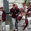 Rockport pitcher Rob Nelson greets teammate Conor Douglass at the plate after Douglass scored during their game against Amesbury at Evan's Field yesterday. Photo by Kate Glass/Gloucester Daily Times