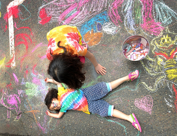 Rockport: Yana Cho 4, lays on the ground while her sister Hana 7, of Hamilton/Wenham outlines her with chaulk at Motif#1 Celebration Day Saturday afternoon. Get three in, get a free tattoo. Desi Smith/Gloucester Daily Times.
