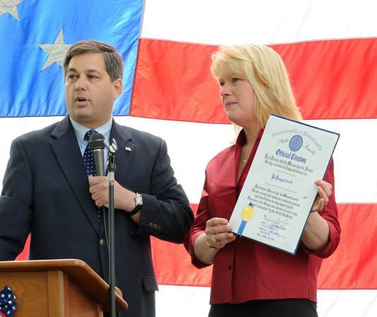 Magnolia:   Lisa Ramos holds a citation she just received from State Senator Bruce Tarr at the unveiling ceremony in Knowlton Park in Magnolia, honoring all service branches Saturday morning. Desi Smith/Gloucester Daily Times.