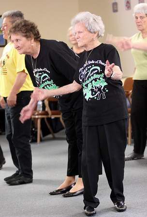 Kit Abrahamson, 104, of Gloucester, performs with the Cape Ann Seniorettes at Day by Day Adult Care Center. Kit broke two ribs in a recent fall, but is back on her feet again just three weeks out of rehabilitation at Seacoast. Photo by Kate Glass/Gloucester Daily Times