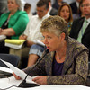 Val Gilman, Chair of the Gloucester School Committee, speaks against continuing with the Gloucester Community Arts Charter School at the Board of Elementary and Secondary Education meeting in Malden yesterday. Photo by Kate Glass/Gloucester Daily Times