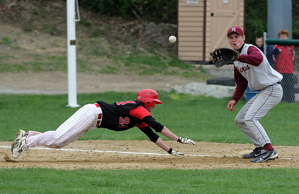 Rockport first baseman Mike Petrino reaches for the ball as Amesbury center fielder John Fournier dives back toward the bag at Evan's Field yesterday. Photo by Kate Glass/Gloucester Daily Times