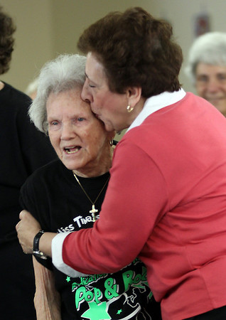 Tina LaFlam of Miss Tina's School of Dance gives Kit Abrahamson a kiss after her first dance with the Cape Ann Seniorettes at Day by Day Adult Care Center. Photo by Kate Glass/Gloucester Daily Times