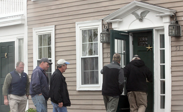 Gloucester: A group of local fishermen head into the Inn at Babson Court yesterday for a private meeting with NOAA Administrator Jane Lubchenco and Assistant Administrator Eric Schwaab to discuss reparations to fishing businesses harmed by excess enforcement. Photo by Kate Glass/Gloucester Daily Times