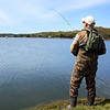 DAVID LE/Gloucester Times. Chuck McCarthy, of Ipswich, casts his fishing line out into the Annisquam River in Gloucester on Friday morning. The bass fishing season has started and many fisherman cast along the Annisquam looking for the perfect catch. 5/13/11.