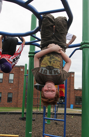 Rockport: Bennet Wilson shows off his skills on the monkey bars while playing with friends during the YMCA's after school program at Rockport Elementary School yesterday. Photo by Kate Glass/Gloucester Daily Times