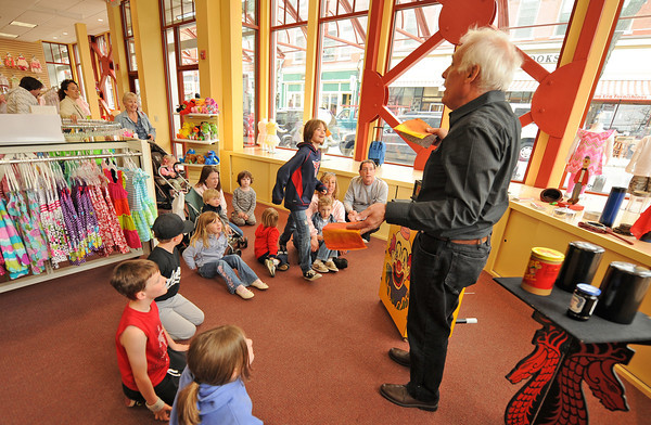 Gloucester: Max Ross AKA Mr Magic inertains some children at Kids Unlimited Grand opening on Main St, Saturday morning. Visitors to the store were also greeted by Micky and Mini Mouse. Desi Smith/Gloucester Daily Times.