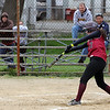 Gloucester's Meghan Keenan connects on a pitch thrown by Swampscott's Stephanie Collins at Burnham Field yesterday. Photo by Kate Glass/Gloucester Daily Times