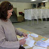 Essex: Sandy Ginn helps assemble a mailing for the Essex census during a lull at the polls yesterday. Photo by Kate Glass/Gloucester Daily Times