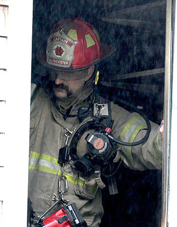 Gloucester Fire Capt Tom Logrande looks at the laundry area were a small fire started at 9 Whites Mt Rd Monday morning. Desi Smith/Gloucester Daily Times.