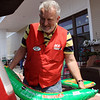 DAVID LE/Gloucester Times. Glenn Nix, of Gloucester, a worker at the brand new Hometown Ace Hardware store in the Gloucester Crossing Plaza, loads a bag of potting soil into a customer's car on Friday during their grand opening. 5/13/11.