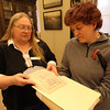 Gloucester: Stephanie Buck, archivist at the Cape Ann Museum, shows Elizabeth Burns a copy of Captain Charles Lenox Sargent's 1818 notebook on the Gloucester sea serpent. Burns is writing her dissertation on the sea serpent. Photo by Kate Glass/Gloucester Daily Times
