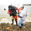 Gloucester: Instructor Tony Defrancesco of (DUI) Diving Unlimited International helps Joe Wesolowsli of Newfields,NH with some final adjustments to his suit,before entering the water, Saturday morning at Stage Fort Park.  Desi Smith/Gloucester Daily Times.
