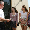 Essex Police Chief Peter Silva accepts a check from Alura Carbrey, Maddie Monagoe, and Julie MacLeod outside the Police Station on Thursday. The girls, along with their friend Ellie Mortillaro, raised $375 to help kids purchase helmets. Photo by Kate Glass/Gloucester Daily Times