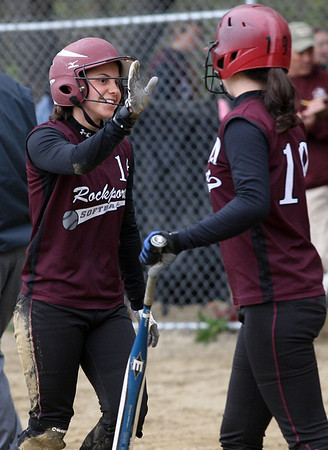 Rockport's Molly Watson, left, gets a high five from her teammate, Gabby Muniz, after Watson hit a home run during their game against Newburyport yesterday. Photo by Kate Glass/Gloucester Daily Times