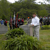 Daniel Tusinski, Deployed Forces Support Director for Commander, Navy Region Mid Atlantic addresses those gathered at Beech Grove Cemetery for Rockport's Memorial Day ceremony yesterday morning. Photo by Gail McCarthy/Gloucester Daily Times