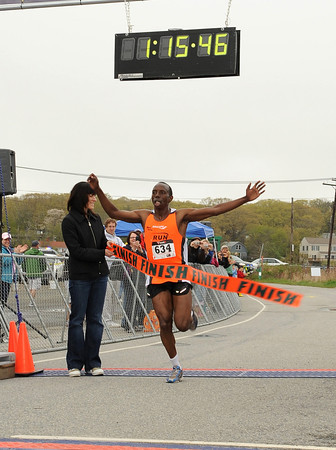 Gloucester: David Ndungu crosses the finish in the Twin Lights Half Marathon with a winning time of 1:15:47 Sunday morning. Desi Smith/Gloucester Daily Times.