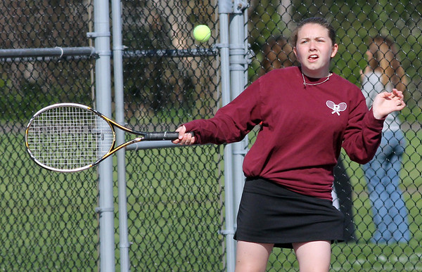 Rockport's Abby Hood returns a serve during their match against Hamilton-Wenham yesterday. Photo by Kate Glass/Gloucester Daily Times