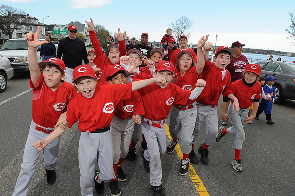 Gloucester:  Little Leauge Reds players parade down Western Ave to Boudreu Field for opening day Saturday morning. Desi Smith/Gloucester Daily Times.