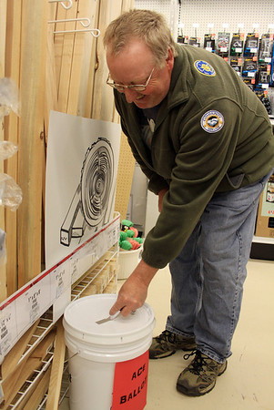 DAVID LE/Gloucester Times. Wayne Moulton, of Gloucester drops a ballot into a bucket at the brand new Hometown Ace Hardware store on Friday afternoon during their grand opening. Hometown Ace Hardware was giving away prizes throughout the day and decorated the store in spooky style for Friday the 13th, which they celebrated by drawing a special ticket at 1:13 for 2 tickets to a North Shore Music Theater show. 5/13/11.