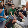 Manchester: Trenton Loughery asks Don Towle if he knows any good basketball moves as they record a Podcast for their social studies unit on their community. Also with Loughery are third graders Madeline Donnellan Valade, Charlotte Pick, and Sofia Makowski. Photo by Kate Glass/Gloucester Daily Times