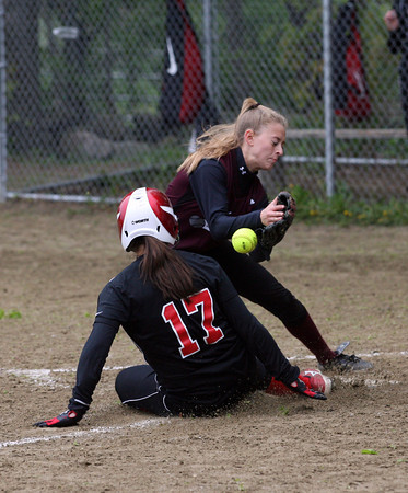 Rockport pitcher Kristen Turner can't make the tag as North Andover's Paige Ahlholm slides safely into home plate in the 7th inning, giving the Knights the 6-4 win. Photo by Kate Glass/Gloucester Daily Times